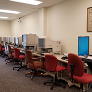 Row of microfilm and microfiche readers